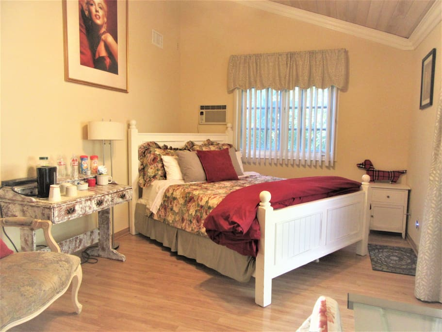 We call this the Marilyn Monroe room. Tons of charm! The property was once owned by actress Mae West.  The place has been professionally decorated in the style of Shabby Chic Country French.