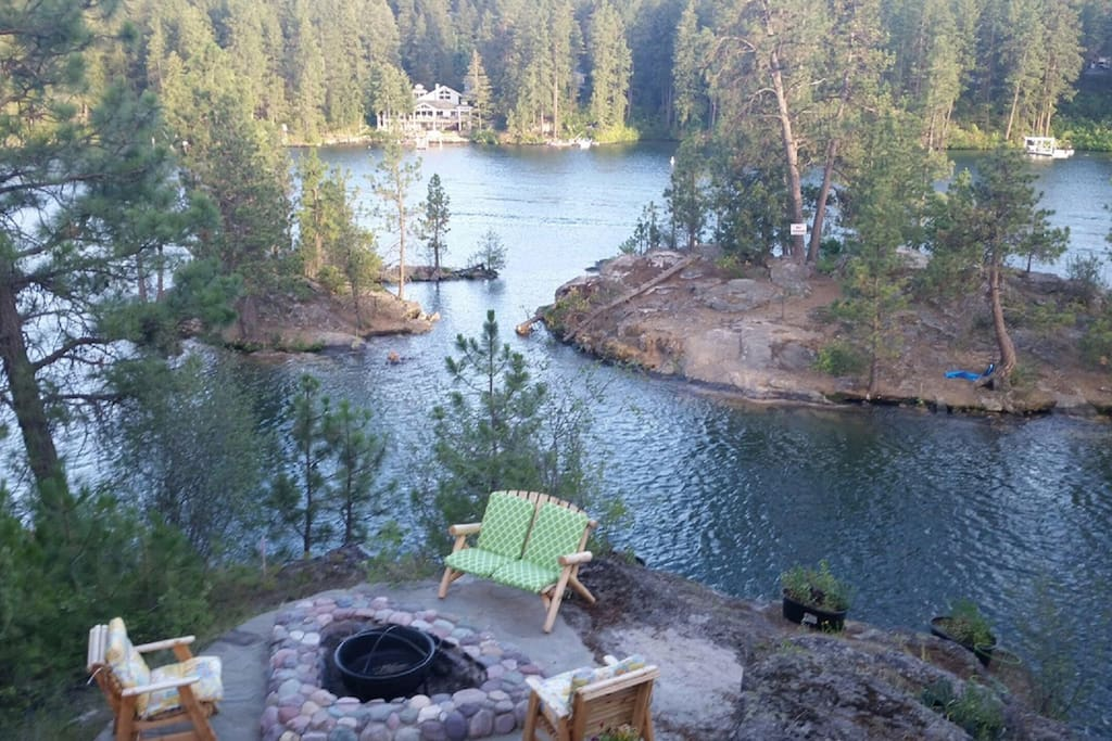 Unit's firepit area overlooking River.  Also has gas barbecue
