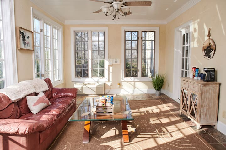 A view standing at your private entrance  looking into your attached living/sunroom room!