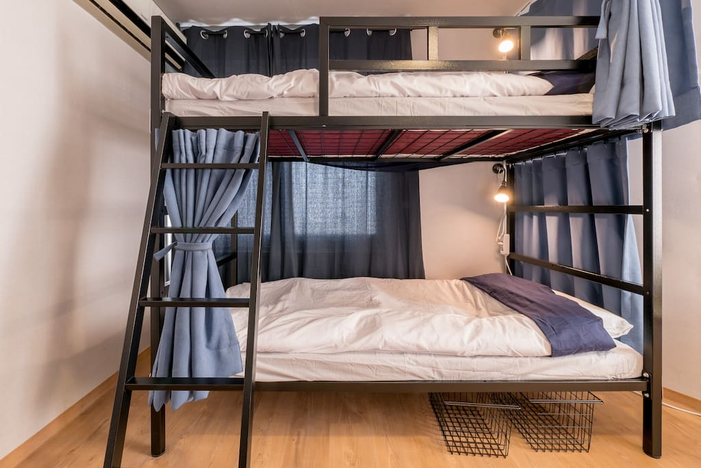 Each bunk has a curtain that provides privacy, a reading light and power outlets.