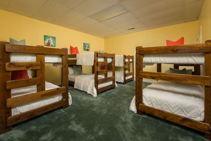 Banana Pudding Suite with 4 bunks for a total of 8 beds with bath down the hall