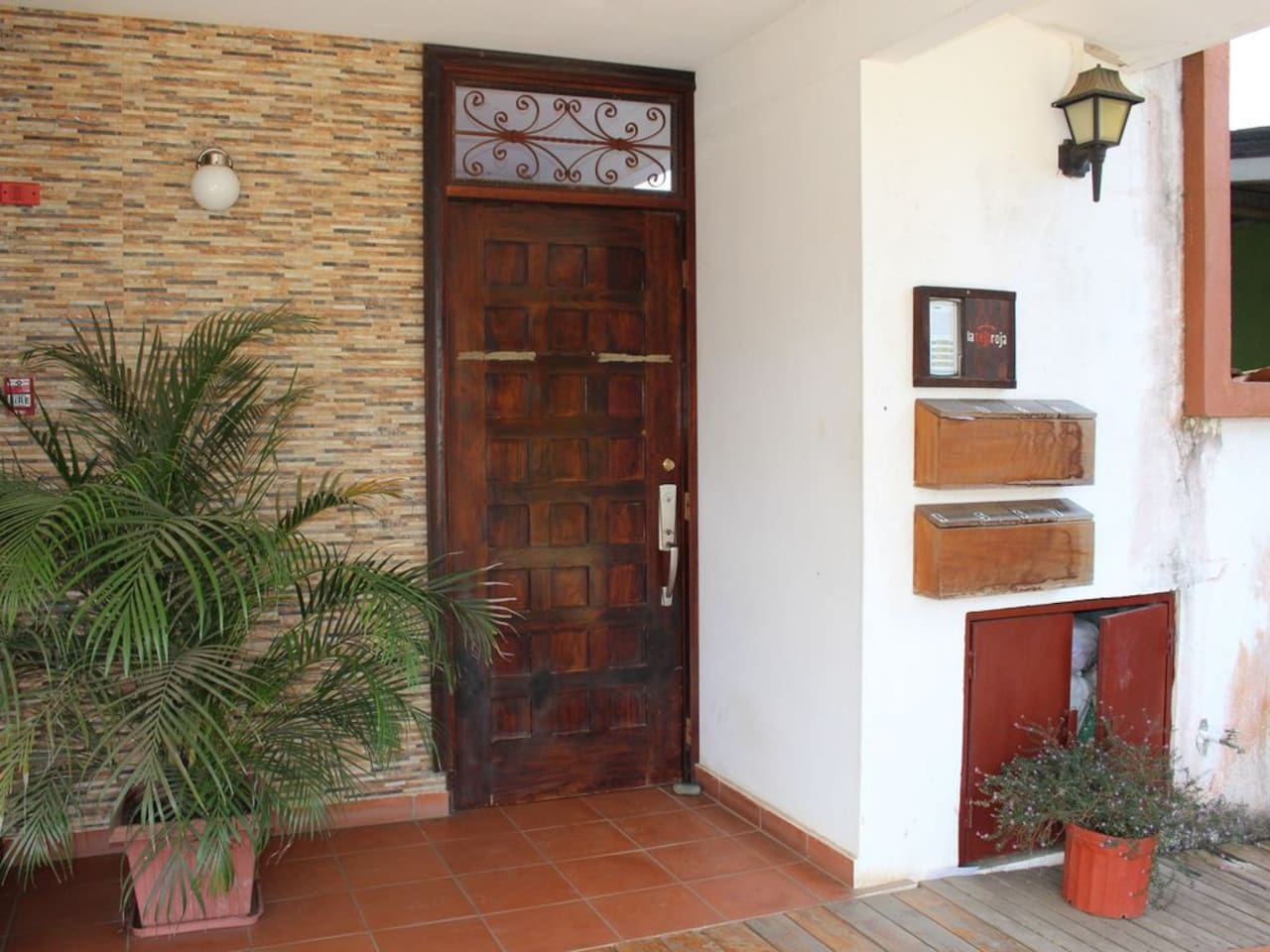 Entrance to the apartment complex La Teja Roja with security door for residents