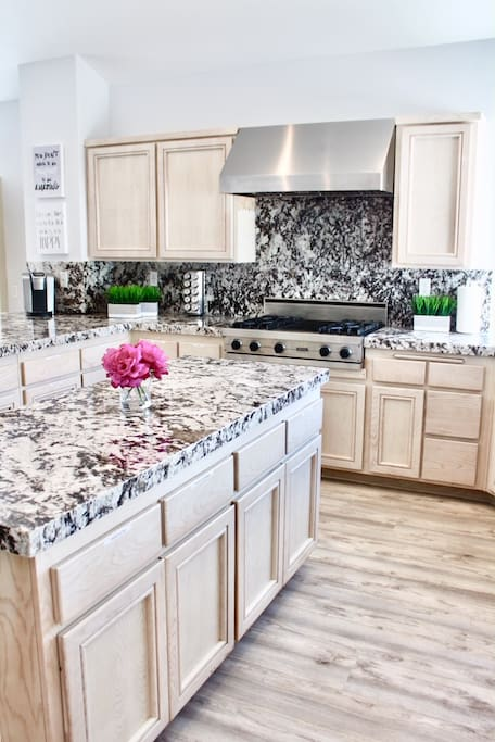 Brand new granite and Viking range (with grill). Updated kitchen! Light and bright with panoramic views! 3 extra large islands (peninsulas and island) in kitchen so each person can have their own area to cook!