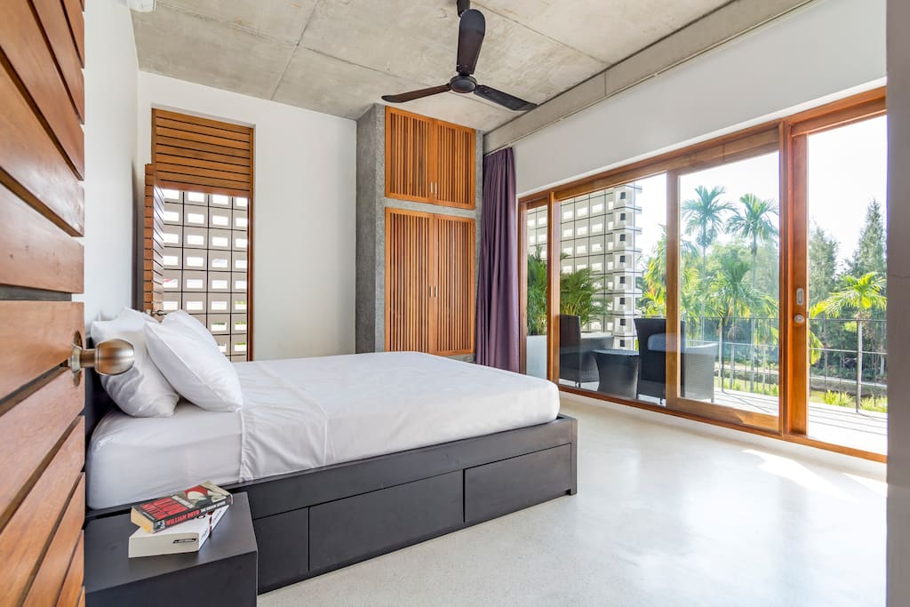 Master bed room 1. King size bed, private balcony with lounge chairs, overlooking the pool and the lush green garden - a piece of quiet paradise