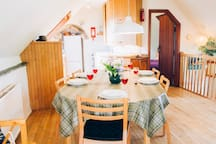 The Cottage Dining table for 8 with Kitchen beyond