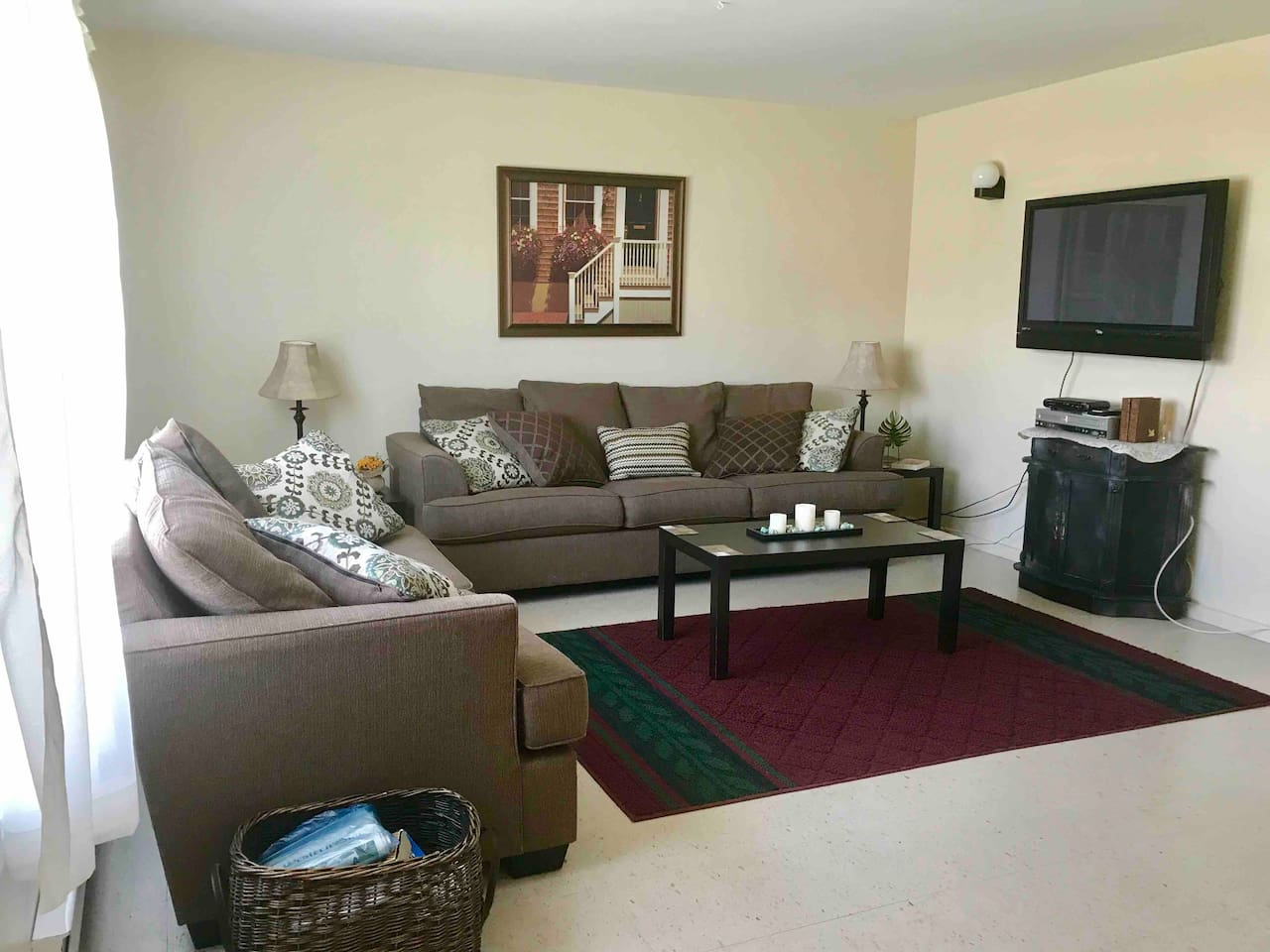 Spacious living room with flat screen television and cable