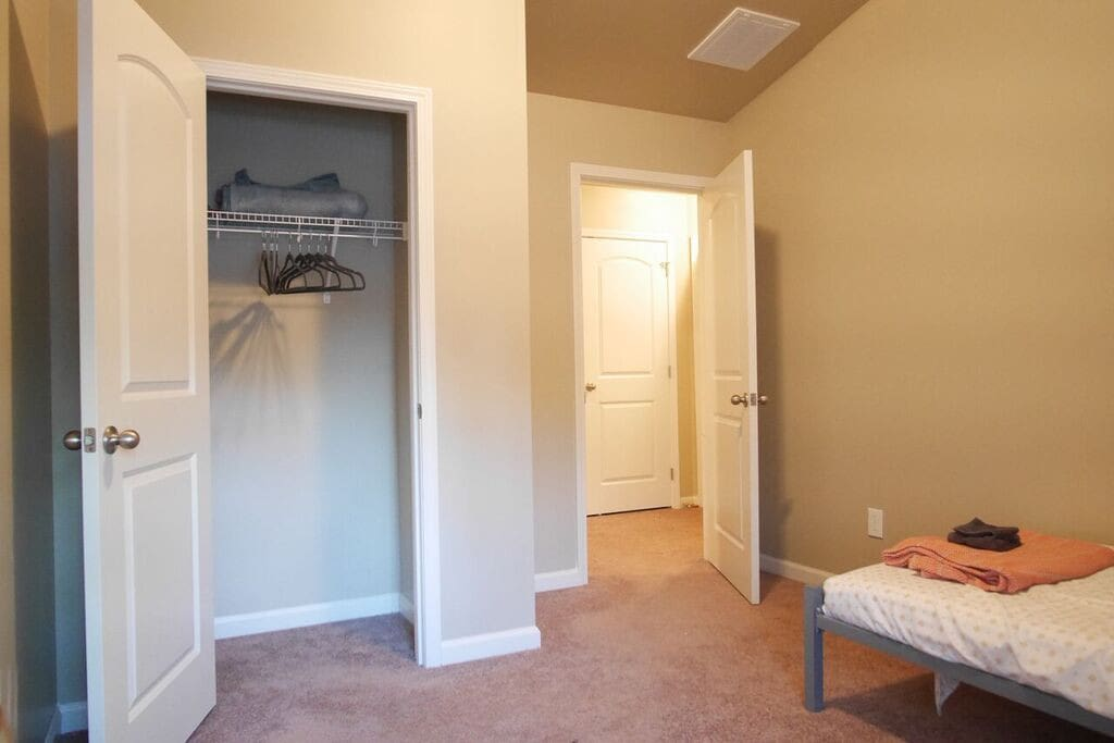 Ample closet space and hangers available.