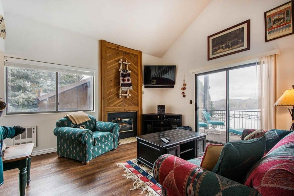 """After a long day of exploring Downtown or skiing, it is nice to return to an open home equipped with plush furniture, entertainment center & 50"""" HDTV."""