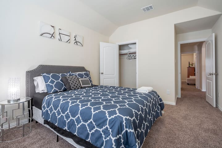 Queen size bed in a upstairs bedroom.