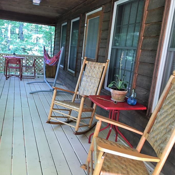 Upper level porch with rockers, hammock, and a bistro table for romantic dining while enjoying the beautiful view.  If you are a bird lover,  there are dozens of birds that come to our porch looking for bird seed.