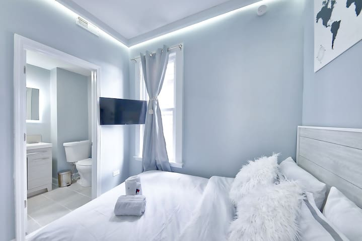 """Bedroom #2: smaller of the two bedrooms, features same indirect lighting, plush 8"""" Zinus double memory foam mattress.  32"""" Roku-enabled television provided"""