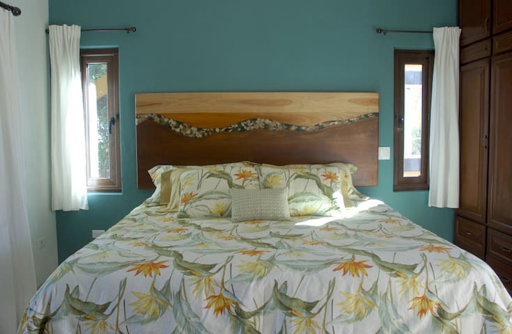 Artist designed headboard with shells, stones and beach glass.