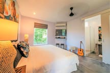 King Sized Bedroom with private en-suite bathroom with shower. This bed can be split into 2 single beds to make a Twin Room.  Leads out to undercover balcony overlooking pool and gardens from 2nd floor