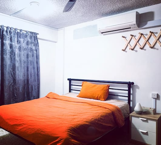 Bedroom with clean washed bedsheets curtain, aircon, side table