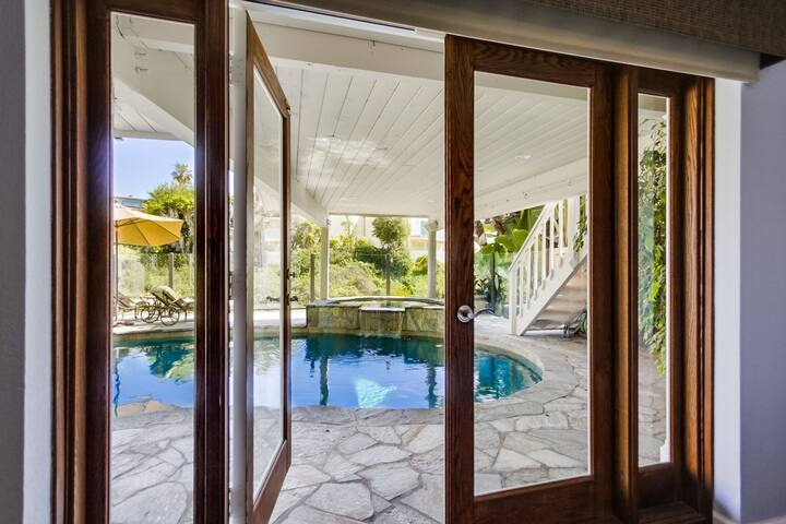 French doors open up to pool area