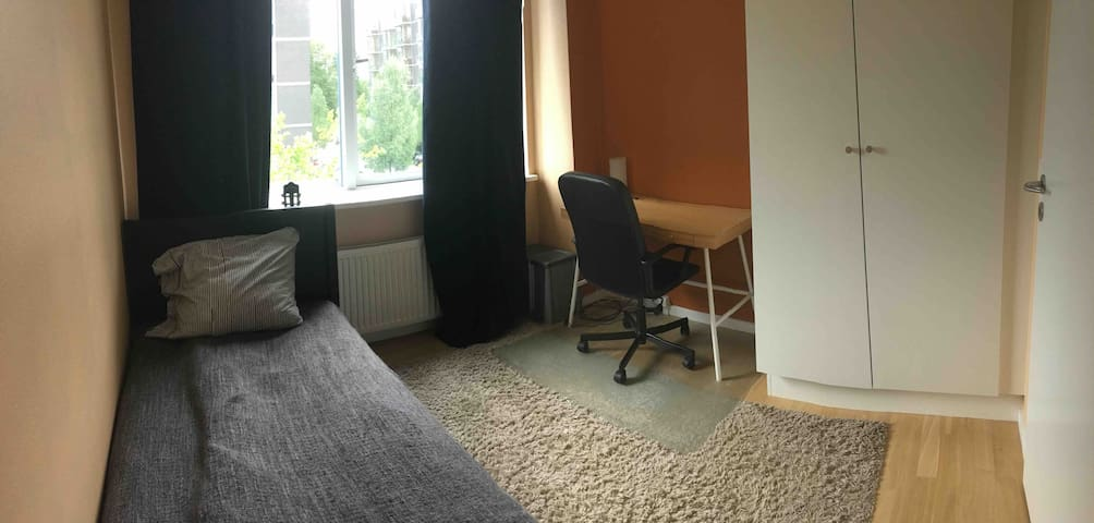 Guest room in a big shared apartment