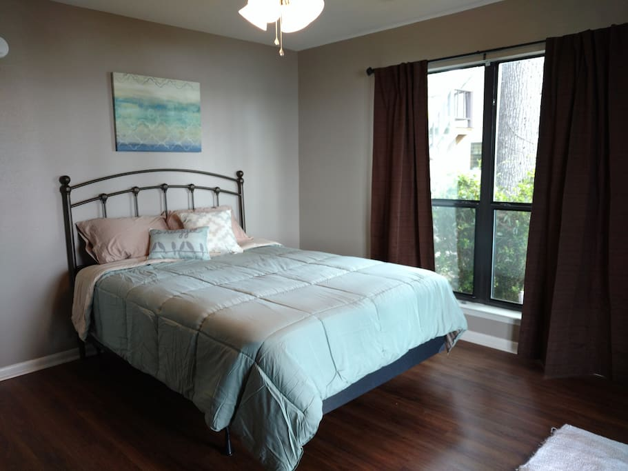1st downstairs bedroom with queen bed a view of the lake!