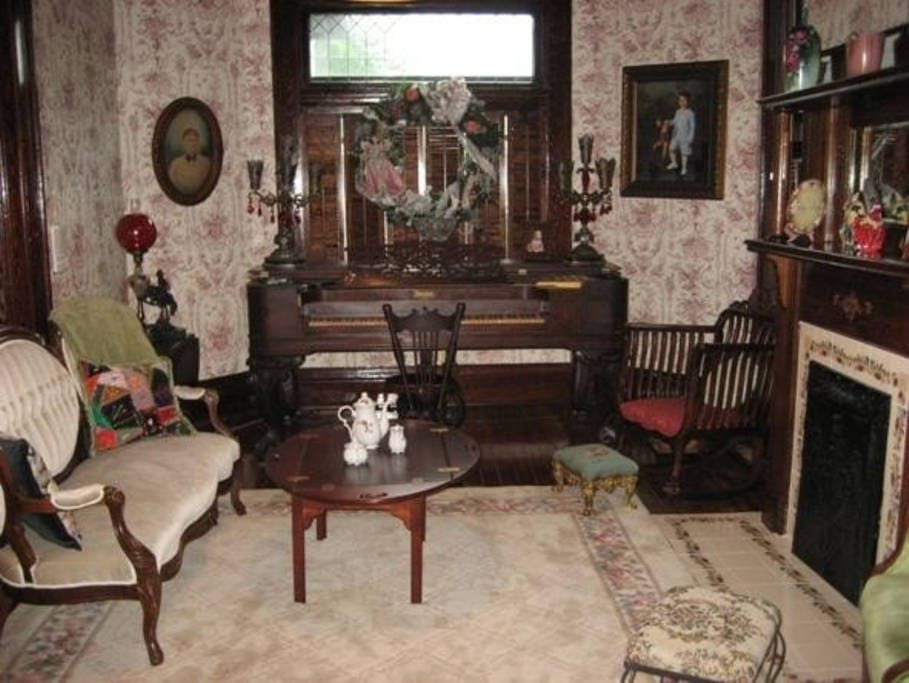 4/22: The focal point of the living room is a square grand piano that was moved from Miss Mable's 1902 Florida home..