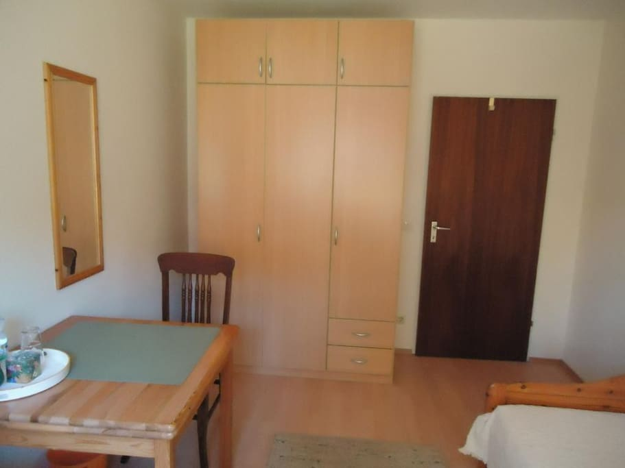 An extendable table. A large wardrobe with plenty of space.