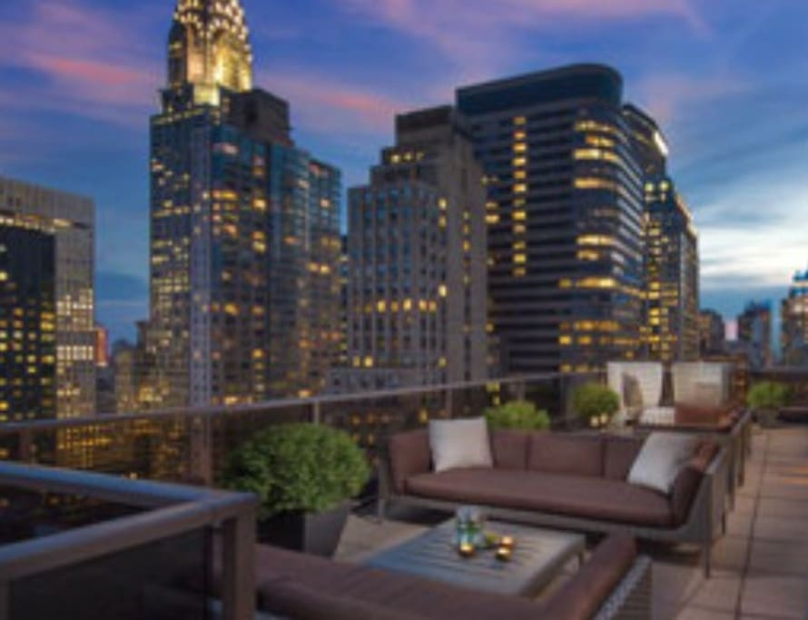 Resort lounge and balcony with great views of the city