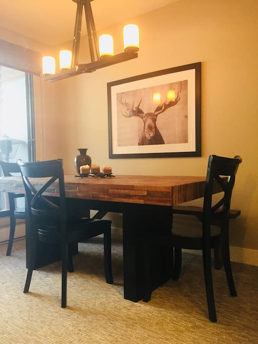 Spacious dining area, seat 8 comfortably around this table crafted from wood reclaimed from a ghost town and antique pine bench seat. Opens onto large outdoor patio with  BBQ.