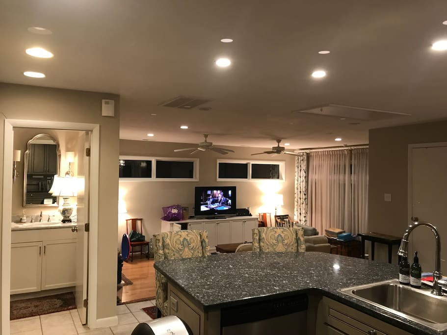 From kitchen down to family room and half bath