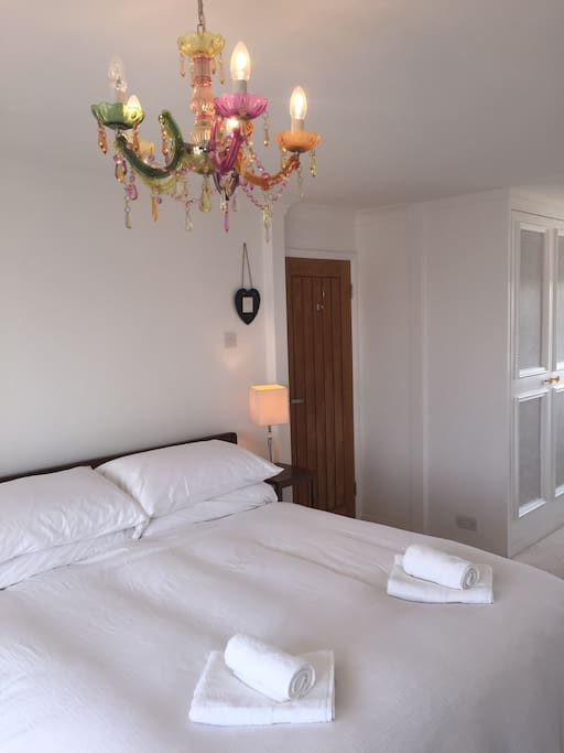 Super king size bed, goose down pillows. Excellent quality mattress. Fresh white bed linen.