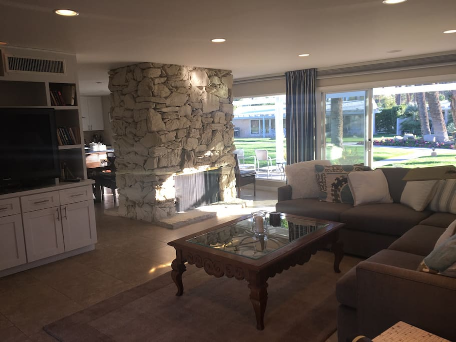 "Living room with 56"" large screen, cable television, overlooking patio and pool area."