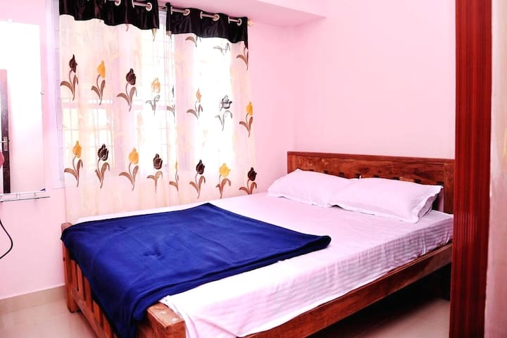 King size cought with attached bathroom.