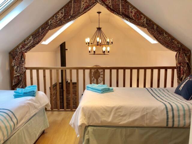 Mezzanine twin bedroom with drapes