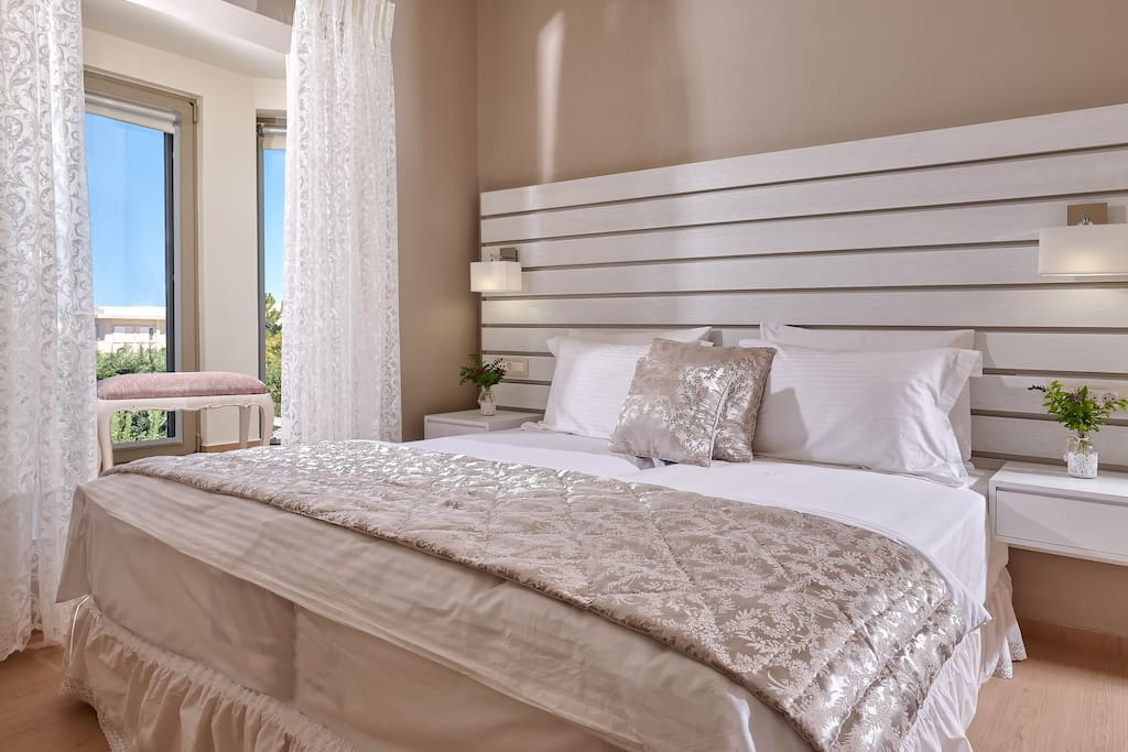Bedroom with views of the city and the mediterranean sea   autonomus satellite over 700 world wide channels  high quality mattresses, pillows & sheets  safety box   aircondition   closet   cleanliness is our priority.