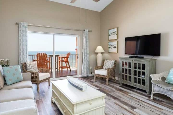 Delightful beachfront condo w/ a furnished balcony, views, & a shared pool