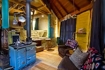 The stove is the heart of the cottage and provides heat, hot water and cooking.