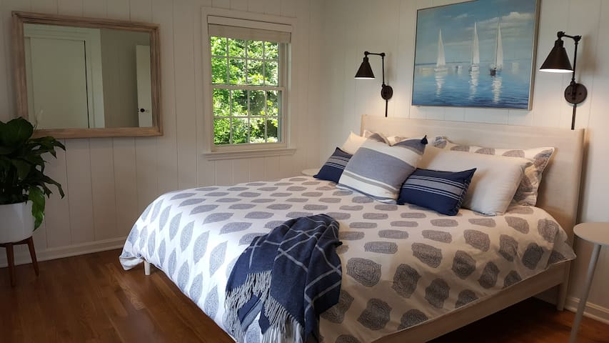 Bedroom #1: Premium West elm mid century King bed with a lake view