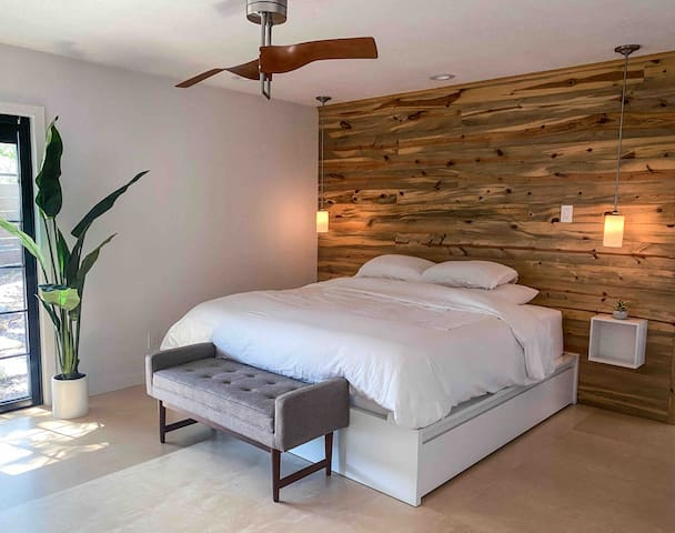 """Welcome to """"the cloud"""" -- the best sleep of your life. Master suite has king size bed with luxurious linens, en-suite bathroom, walk-in closet & access to the hot tub deck."""