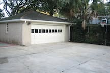secure back yard and garage with parking for 8 vehicles