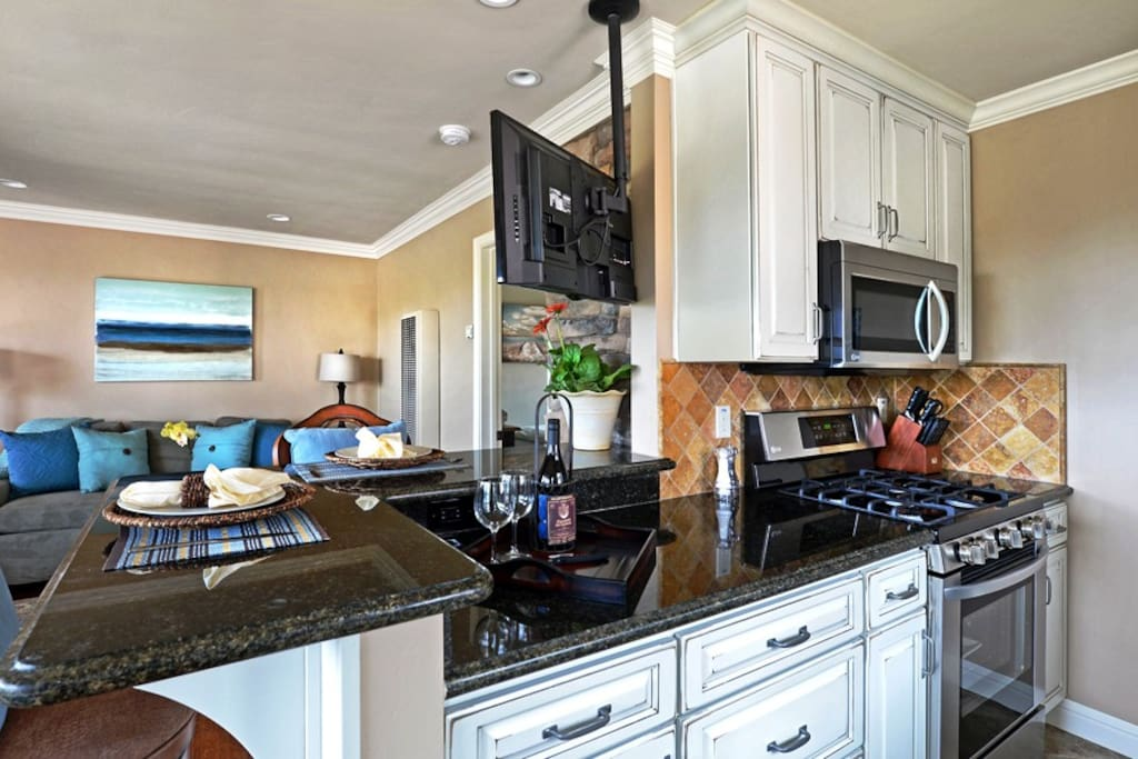 Custom Cabinets, Granite Counters and Chef Quality Stainless Appliances.