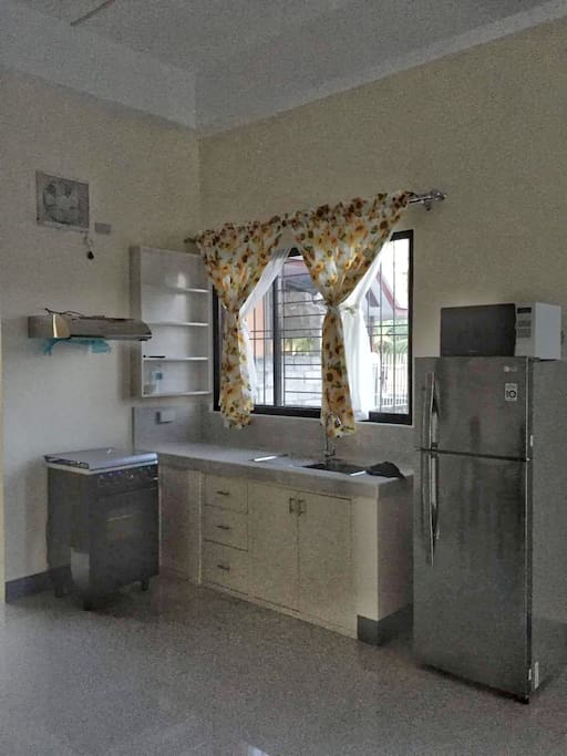 Fully-equipped kitchen with Gas Range Oven, Microwave, Rice Cooker, and Refrigerator