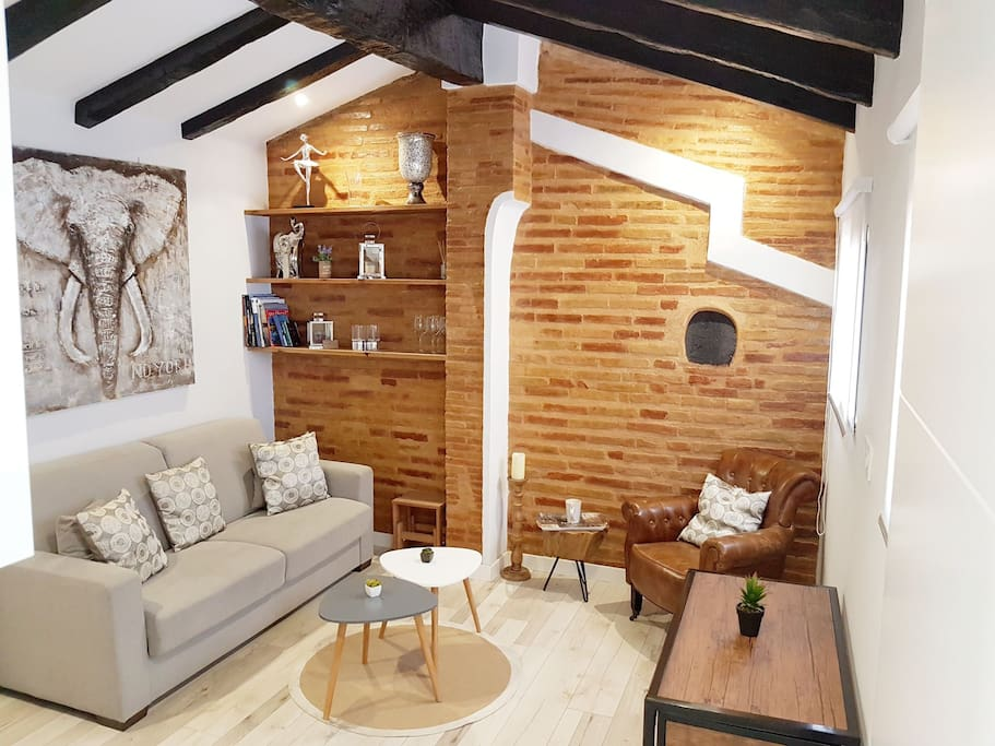 salon with old beams and traditional stone