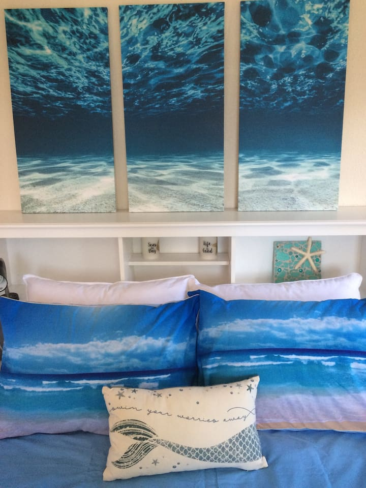 Queen size bed with an underwater scene above your heads.