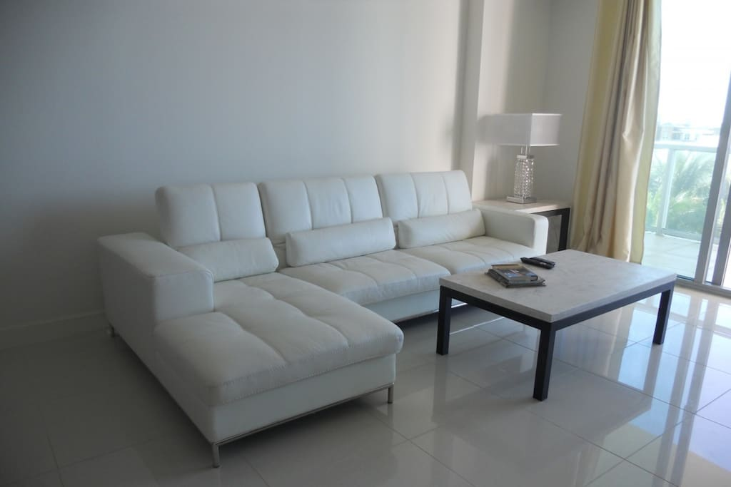 Beautiful Living area with leather couch and Marble floors