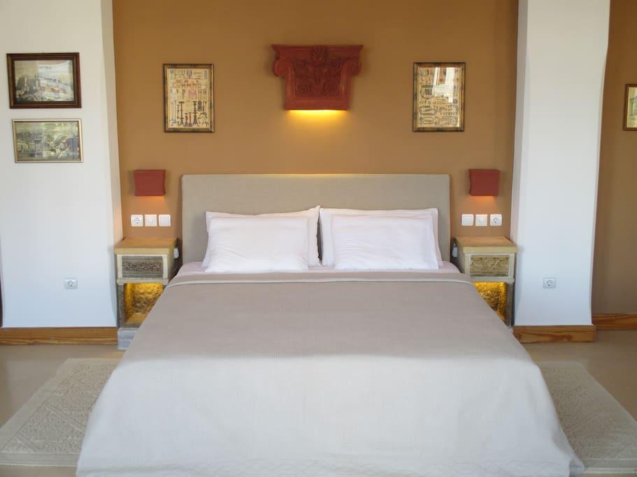 Brand new bed and mattress with custom ceramic lighting.
