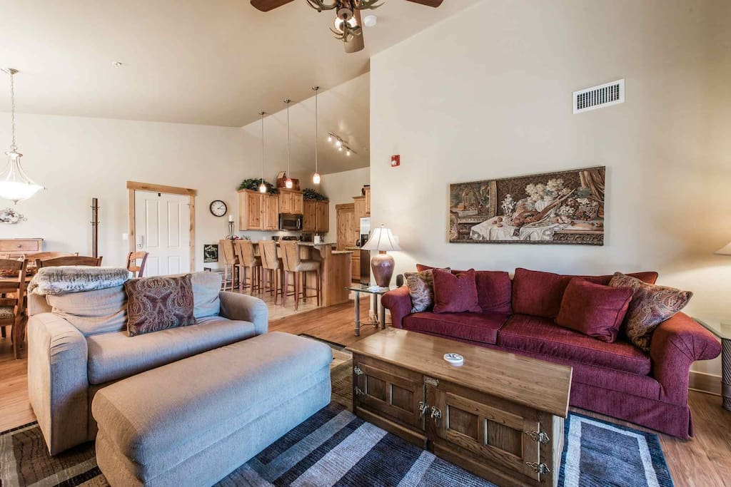 The living room has an HDTV, entertainment center, offers access to your private mountain facing balcony, gas fireplace and comfortable furnishings.