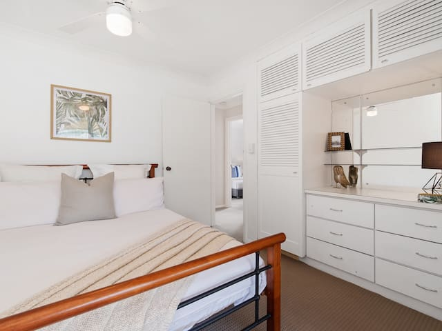 Bedroom 3 has been thoughtfully designed to accommodate all ages. With private glass sliding door access to the backyard patio and pool, and ample storage.