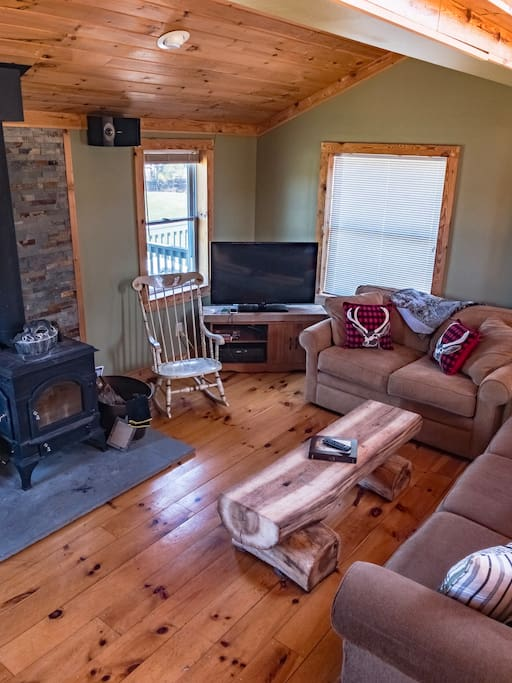 Cozy, open living room area with great wood burner!