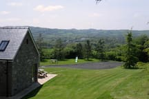 This gives you an idea of our location and views.  The lawned area tends to be used exclusively by guests ti Gwennol.