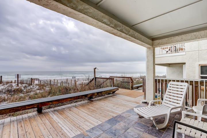 Lovely first floor condo w/ ocean views, patio, & grill - steps from the beach!