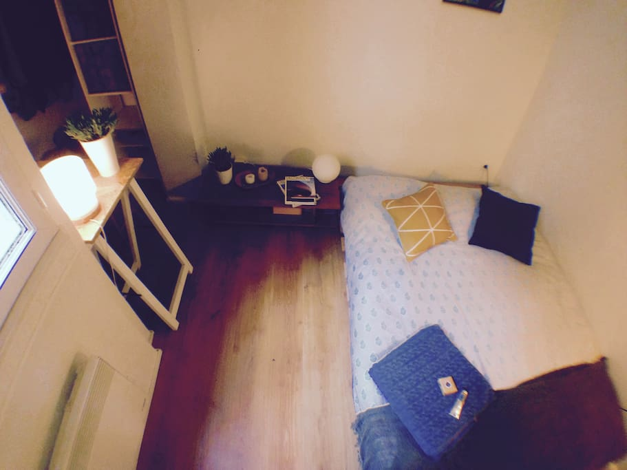 The bedroom is small but well-organised with a big and comfortable double bed, and  an alcove for the desk and the closets.