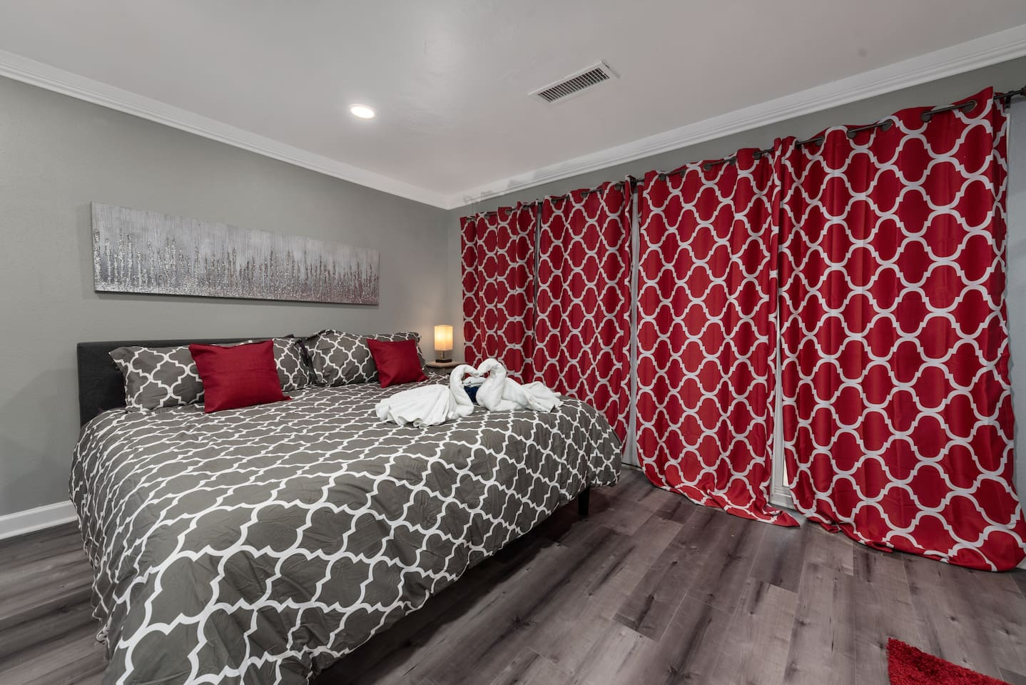 King bed in efficiency unit for getaway couples and med center visit