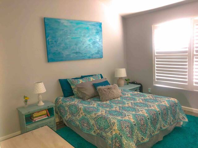 Master bedroom. Queen bed. Coastal shutters. Extra towels, blankets, and sheets.